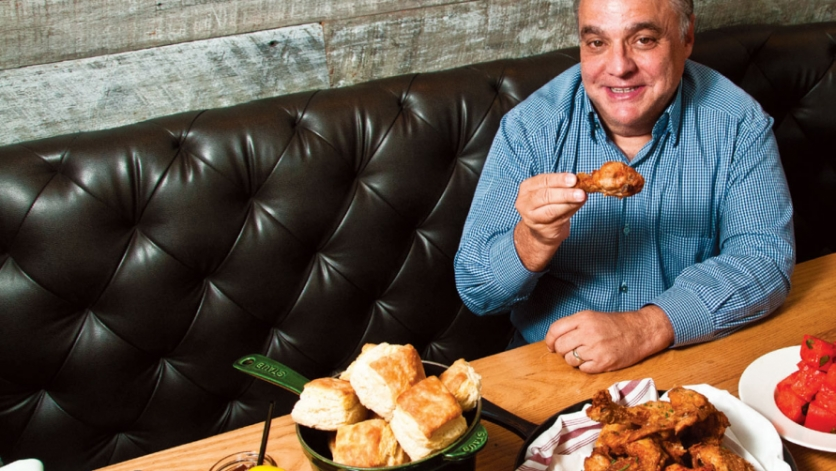 Lee Schrager at Yardbird with a panful of fried chicken, biscuits and Blackberry Bourbon Lemonade