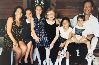 Lois Weisberg (center) surrounded by family members