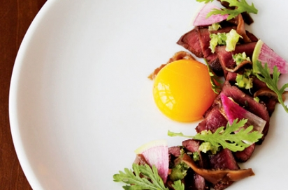 Pan-seared beef heart with egg yolk