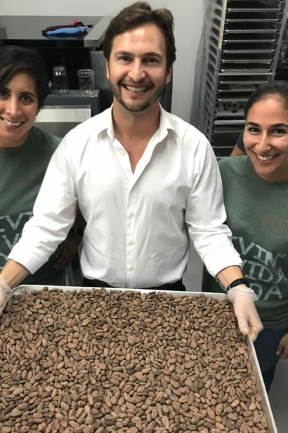 Ryan Amsel displays a tray of cacao beans