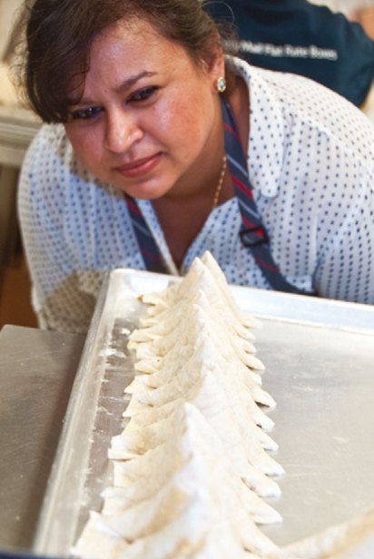 Nisha inspecting samosas