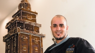 Chef Vincent Catala in front of the gingerbread Freedom Tower